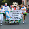 Newburyport: The Ieam from Seacoast Orthopedic Associates makes it's way down Federal Street in the Yankee Homecoming Bed Race in Newburyport Thursday night. Jim Vaiknoras/Staff photo