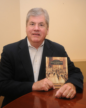 "Newburyport: Dyke Hendrickson, a Newburyport resident, recently wrote  ""Franco-Americans of Maine"" (Arcadia Publishing Co. -- in bookstores June 21), which depicts the lives of French canadians in Maine through 200+ photos and text. Thirty years ago he also wrote ""Quiet Presence: Stories of Franco-Americans in New England."" Through his research, he said the local area has a strong French-Canadian heritage, as well. Jim Vaiknoras/Staff photo"
