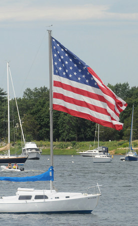 Newburyport: A sail boat moored off Cashman Park in Newburyport flies a large American flag from it's mast Sunday. Jim Vaiknoras/Staff photo