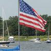 Newburyport: A sail boat moored off Cashman Park in Newburyport flies a large American flag from it's mast Sunday. Jim Vaiknoras/Staff photo