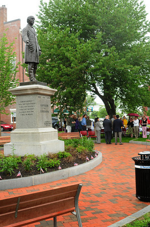 Newburyport: Officials speak to a crowd of about 35 people, who huddled under the giant cherry tree as it started to drizzle, at Brown Square. Next to the statue of William Lloyd Garrison they were celebrating the renovation of the square which dates to 1801. Bryan Eaton/Staff Photo