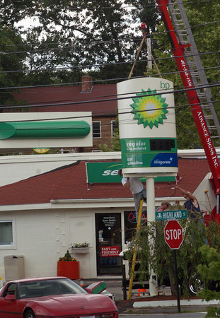 Amesbury: The former Getty Station on Route 110 in Amesbury gets a BP sign erected yesterday morning. Bryan Eaton/Staff Photo