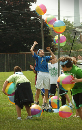 """Newburyport: Molin School students play a wacky game of volleyball with dozens of beach balls in """"The Beach is Dirty"""" station. The children were having their field day styled after the television series Survivor. Bryan Eaton/Staff Photo"""