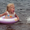 Amesbury: Kylie Smith, 2, of Amesbury has fun with family at Lake Gardner Beach on Thursday morning cooling off in the hot and humid weather. Temperatures cool and the weather drier this weekend with a small chance of a passing shower. Bryan Eaton/Staff Photo