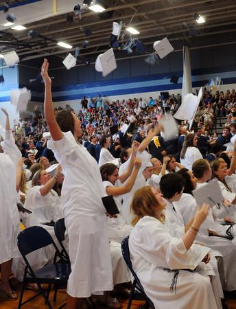 Byfield: Triton gradutes throw their caps into the air after receiving their diplomas. Bryan Eaton/Staff Photo