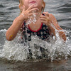 Amesbury: Ayva Bezanson, 4, pops out of the water at Lake Gardner Beach on Monday afternoon cooling off with friends and their mothers. The rest of the week looks more seasonable and less humid. Bryan Eaton/Staff Photo