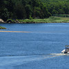 Newburyport: A boat heads down the Merrimack River past a sandbar to the south side of Eagle Island at low tide. Photo was taken looking east from the Chain Bridge. Bryan Eaton/Staff Photo