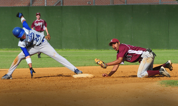 Lowell: Georgetown's Danyer Fabian makes the steal at second past Rockport's Andres Contreras. Bryan Eaton/ Staff Photo