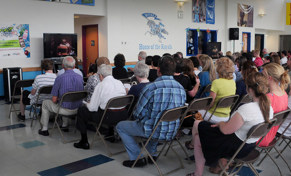Georgetown: Rain forced the Georgetown HIgh graduation into the auditorium where some watched on closed-circuit television in the cafeteria. Bryan Eaton/Staff Photo