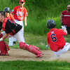 Amesbury: Amesbury catcher Collette waits for the ball as Saugus player #6 makes it home. Bryan Eaton/Staff Photo