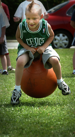 Amesbury: Celtics fan Ben Park, 7, moves along on the Hoppity Hop at Amesbury Elementary School on Wednesday. He was competing in the school's Field Day. Bryan Eaton/Staff Photo