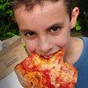 Amesbury: Jack White, 8, of Amesbury devours one of two slices of pizza from Naples at the Amesbury Day's Block Party. Bryan Eaton/Staff Photo
