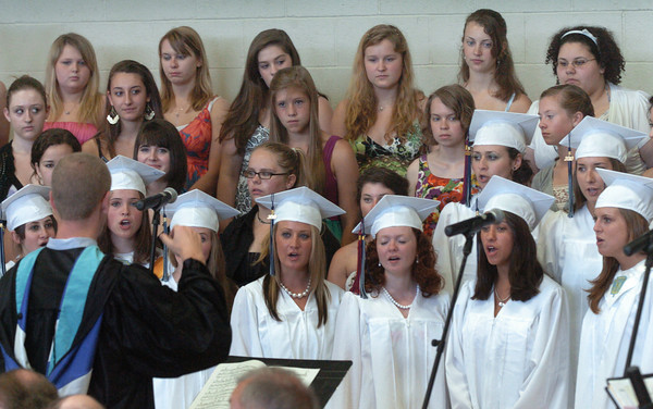 """Byfield: The Triton High School Singers, with graduating seniors singing in the group for the last time, sing """"Whenever You Remember."""" Bryan Eaton/Staff Photo"""