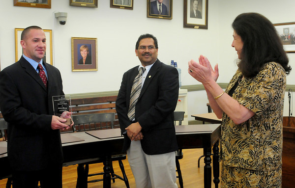 Newburyport: Mayor Donna Holaday applauds city health agent Bob Bracey, left, after recieving his award from Larry Ramdin, president of Massachusetts Environmental Health Association. Bryan Eaton/Staff Photo