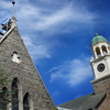 Newburyport: Jeremy Brown, pictured, and Ray Bourgeois of Richard Irons Restoration Masons from Limerick, Maine lower an 18th-century Victorian finnial atop St. Anna's chapel at St. Paul's Church into place with the assistance of a crane. Three finnials total were put into place as part of the historic church's restoration, funded in part by Community Preservation Funds.  Bryan Eaton/Staff Photo