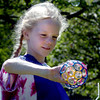 Newburyport: Ella Dooling, 6, uses a sphere with many holes to create bubbles at Waterfront Park on Tuesday morning. The kindergartners at Newburyport  Montessori School were having Bubble Day with other activities too as one of their year-end events. Bryan Eaton/Staff Photo
