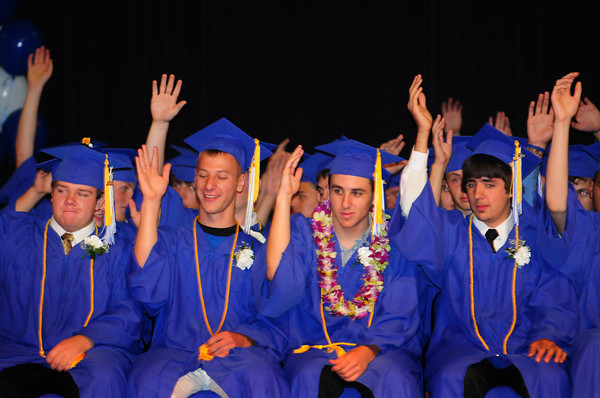 Georgetown: Georgetown High graduates raised their hands when Superinten dent Carol C. Jacobs asked how many had done community volunteer work when engaging them in her speech. Bryan Eaton/Staff Photo