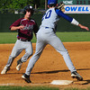 Lowell: Georgetown third baseman Will Ingraham has the ball forcing Rockport's Scott Noble out. Bryan Eaton/Staff Photo