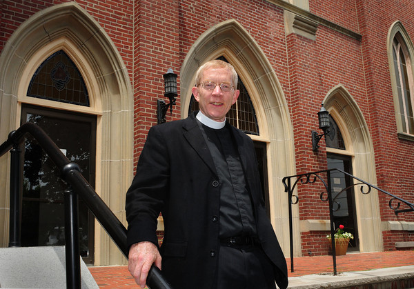 Amesbury: Father Michael Morse of the Anglican Church in Amesbury outside the former Sacred Heart Church which is now home to the church. 100 bishops are meeting their this week to anoint All Saints as the ACNA's official Anglican Diocese in New England, Bryan Eaton/Staff Photo