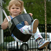 Newburyport: Rebecca Goulet, 22 months, has fun swinging at the playground at the Bartlet Mall yesterday afternoon. The Newburyport girl was there with  her grandparents Richard and Barbara also of Newburyport. Bryan Eaton/Staff Photo