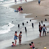 Salisbury: Pilings stick out of the sand at Salisbury Beach, a remnant of the Frolics, as people enjoy the Atlantic Ocean yesterday afternoon. The beach should be much more crowded this weekend with the Sand and Sea Festival on tap with nice weather as well. Bryan Eaton/Staff Photo