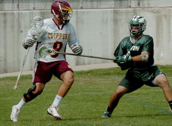 Newburyport: Austin Prep's Bradon Hartt puts the defense on Newburyport's Andrew Sokol. Bryan Eaton/Staff Photo