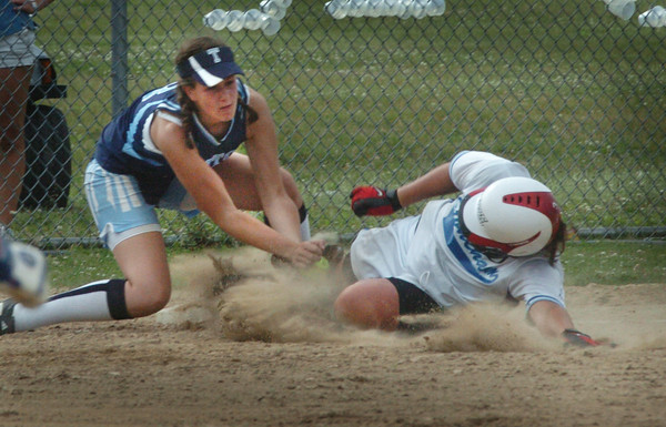 Stoneham: Triton third baseman gets a Stoneham player out in the fifth inning. Bryan Eaton/Staff Photo