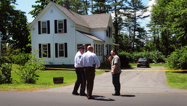 Salisbury: A state trooper Robert LaBarge from the District Attorney's office is met by Salisbury Police, Lt. Kevin Sullivan, left, and Salisbury Detective Sgt. Anthony King, right,  at a home on Old Elm Street in Salisbury where a man recieved a gunshot wound Monday morning. Bryan Eaton/Staff Photo