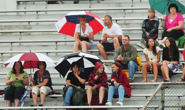 Newburyport: Newburyport fans watching the high school boys lacrosse team host Swampscott had umbrellas in hand during yesterday's sprinkles. After a seasonable day today, rain returns tomorrow. Bryan Eaton/Staff Photo