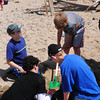Amesbury: Amesbury Middle School students dig holes in the beach at Sandy Point on Tuesday morning checking how many levels there are in two feet, learning about the dynamics of ever-changing barrier island beaches. They were at the state park at the southern end of Plum Island doing various science experiments from their curriculum.  Bryan Eaton/Staff Photo