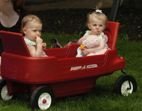 Newburyport: Twins Ellison Talbot, left, and Lauren, 17 months, munch on crackers behind the Firehouse Center watching children play on Waterfront Park on Friday afternoon. The two, from Amesbury, were there with their mother, Dena, with her friends and their children. Bryan Eaton/Staff Photo