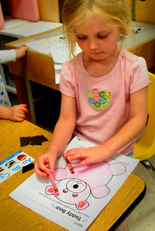 Amesbury: Penny Miller, 4, completes filling in a drawing of a teddy bear at the Cashman School in Amesbury to take home. Yesterday was the last day for pre-schoolers and they celebrated with a Teddy Bear Party. Bryan Eaton/Staff Photo