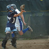 Stoneham: A Stoneham player scampers past Triton catcher Vanessa Eissen to score their second run. Bryan Eaton/Staff Photo