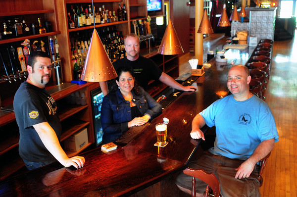 Amesbury: Managers and owners of the new Ale House, in the space formerly the home of Powow Grille, are ready to open today. From left, Matt Chase, Lisa Duggan, Greg Haley and Jeff Nahas. Bryan Eaton/Staff Photo