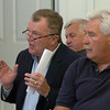 Newbury: Bob Connors, next to Ron Barrett, right, asks for clarification about beach scraping in other states at a meeting about Plum Island erosion last night at PITA Hall. Bryan Eaton/Staff Photo