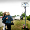 Salisbury: Kelsey Chandonnet, girlfriend of the late Jordan Shea, and his mother Holly, embrace as a sign to Salisbury Beach State Reservation was unveiled which named the road after the soldier who died in Iraq. The Amesbury resident worked summers at the reservation. Bryan Eaton/Staff Photo