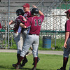 Lowell: Rockport players embrace Andres Contreras after coming home in their first run of the game against Georgetown. Bryan Eaton/Staff Photo