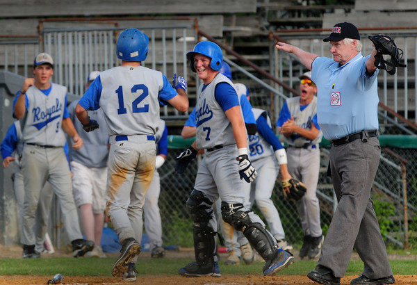 Lowell: Georgetown's Ryan Browner is greeted by teammates scoring a run in the bottom of the second against Rockport. Bryan Eaton/Staff Photo