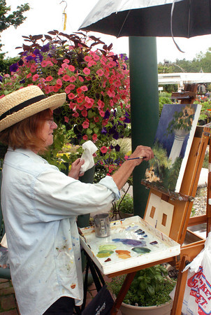 Salisbury: Mary Ann Varoski of Plum Island paints a floral scene at Pettengill Farm in Salisbury. She was one of the working artists on hand for the farm's first Arts and Flowers Day. Bryan Eaton/Staff Photo