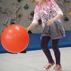Madelyn Creps, 8, dribbles a giant ball in Margaret Welch's gym class at Amesbury Elementary School on Tuesday. The second grade classes were practicing different activities for next week's Field Day. Bryan Eaton/Staff Photo