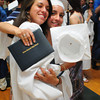 Byfield: Triton classmates Sara Arango, left, and Amanda Killam embrace after graduating Saturday. Bryan Eaton/Staff Photo