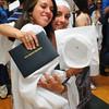 Byfield: Triton classmates Sara Arango, left, and Amanda Killam embrace after graduating Saturday. Bryan Eaton/Staff Photo
