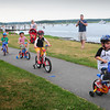 Newburyport: Children ride in a parade from Cashman Park toward the Rail Trail yesterday afternoon to celebrate the Newburyport Mother's Club donation of $5,000 to the Rail Trail which was accepted by Senior Project Manager Geordie Vining of the Newburyport Planning Department. Bryan Eaton/Staff Photo