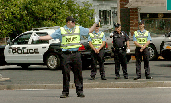 Salisbury: Salisbury Police officer Mike Alder, second from right, helps train parking officers in traffic control at School Street and Route One. Bryan Eaton/Staff Photo