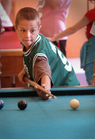 Salisbury: Chase Turner, 9, of Amesbury starts in a game of pool at the Boys and Girls Club on Wednesday morning. The club, which is closed the week after school lets out, reopened for the summer on Monday. Bryan Eaton/Staff Photo