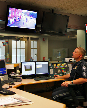 Newburyport: Officer Howie Adams monitors the traffic camera on State Street in downtown Newburyport from the desk at the police station Monday afternoon. Three traffic cameras have been set up in the downtown area and can be manipulated from the police station. Photo by Ben Laing/Staff Photo