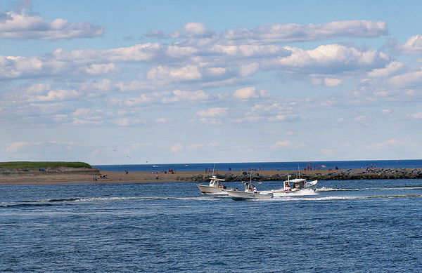 Newburyport: Three boats pass eachother at the mouth of the Merrimack River off of Plum Island Point Wednesday afternoon. Photo by Ben Laing/Staff Photo