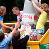 Rowley: Sixth graders from the Pine Grove School's student council fill a recycling container with materials from the school Wednesday afternoon. Photo by Ben Laing/Staff Photo
