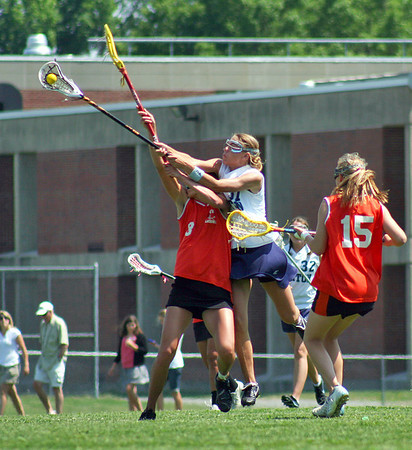 Byfield: Triton's Jen Rock (37) out leaps an Ipswich player during the Vikings' 14-10 win over the Tigers in the first round of the state tournament Wednesday. Photo by Ben Laing/Staff Photo