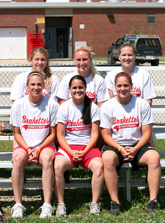 Amesbury: Amesbury's own Ashley Waters, center front, returned to her hometown to help her former softball coach, Chris Perry, with his Amesbury Youth Softball Clinic Tuesday morning. Waters brought with her some of her teammates from the Stratford Brakettes, Carly Normandin, front left and Jessica Serio, front right, along with Rahele Fico, top left, Jessica Mouse, top center, and Whitney Canion, top right. Photo by Ben Laing/Staff Photo